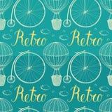 葡萄酒热空气气球和自行车。蓝色backgrou 免版税库存照片
