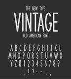 葡萄酒狭窄的类型,现代书信设计,老美国字体 白色减速火箭的信件和数字在黑背景设置了 库存例证