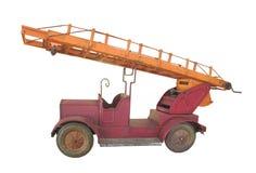 葡萄酒玩具金属查出的消防车。 免版税图库摄影