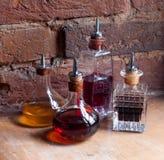 葡萄酒瓶用五颜六色的魔药 库存照片