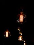 葡萄酒白炽光在黑色的电灯泡细丝 免版税图库摄影