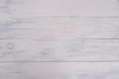 葡萄酒白色木桌背景 库存图片