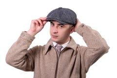 葡萄酒的年轻人在白色穿衣与帽子, 1930称呼, 库存图片