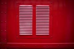 葡萄酒红色公共汽车的通风孔 库存照片