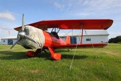 葡萄酒红色双翼飞机 图库摄影
