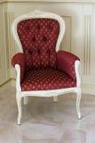 葡萄酒红色扶手椅子 库存图片