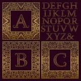 葡萄酒组合图案成套工具 金黄被仿造的信件和华丽方形的框架的创造最初的商标在古色古香的样式 免版税图库摄影