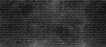葡萄酒老深黑色洗涤砖墙纹理 您的文本或图象的全景背景 免版税库存图片
