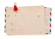 葡萄酒航空邮件信封。减速火箭的圣诞节岗位信件 免版税库存照片