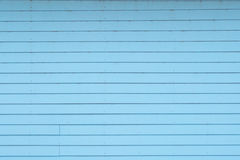 葡萄酒蓝色木背景 免版税图库摄影