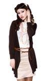 葡萄酒衣裳的美丽的女孩 免版税库存图片