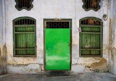 葡萄酒门和窗口在老墙壁上 免版税图库摄影