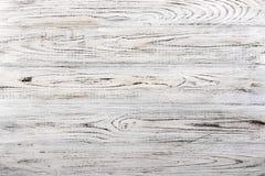 葡萄酒风化了破旧的白色被绘的木纹理作为背景 免版税库存图片
