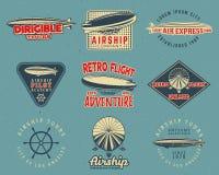 葡萄酒飞艇被设置的商标设计 减速火箭的飞船证章汇集 飞机标签传染媒介设计 老飞艇设计 皇族释放例证