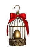 葡萄酒鸟笼用金黄鸡蛋 库存图片