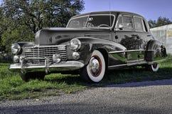葡萄酒1941年汽车在一条农村得克萨斯路停放了 库存图片