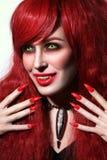 葡萄酒年轻美丽的红头发人妇女样式画象有得到的 免版税库存照片