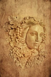 葡萄头发的希腊妇女灯台雕象织地不很细背景  库存照片