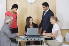 董事在会议在办公室 免版税库存图片