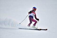 蒂娜萨顿纪念品-障碍滑雪滑雪竞争 免版税库存图片