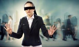 年轻蒙住眼睛的妇女 免版税库存照片