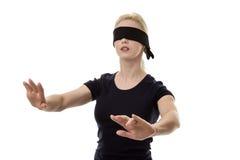 蒙住眼睛的妇女 免版税库存照片