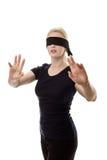蒙住眼睛的妇女 库存图片