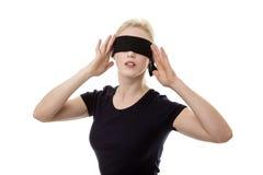 蒙住眼睛的妇女 库存照片