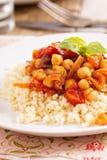 蒸丸子用鸡豆和菜炖煮的食物 库存图片