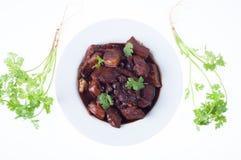 蒸汽与蔬菜的猪肉行程 免版税库存照片