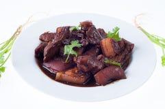 蒸汽与蔬菜的猪肉行程 库存图片
