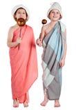 蒸汽浴布料的两个年轻滑稽的男孩 库存图片