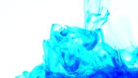 蓝墨水水 创造性的慢动作 在一个空白背景 免版税图库摄影