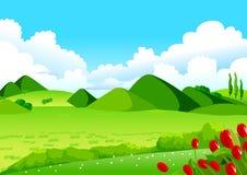 蓝天、绿色领域和遥远的小山 库存照片