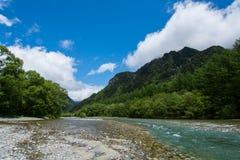 蓝天和一点小河 库存照片