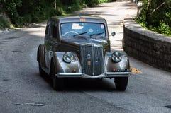 蓝旗亚APRILIA 1500 1949年在一辆老赛车 免版税库存照片