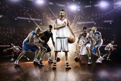 从蓝球运动员的拼贴画对盛大竞技场的行动的 免版税库存照片