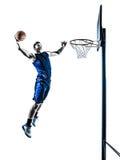 蓝球运动员跳跃的泡的剪影 免版税库存图片