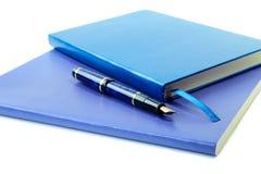 蓝皮书黑暗的钢笔文字 免版税库存照片