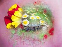 蓝眼睛开花构成隐喻春天妇女 免版税库存图片