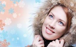 蓝眼睛性感的冬天 免版税库存图片