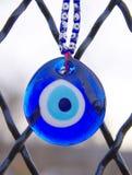 蓝眼睛护符 库存图片