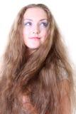 蓝眼睛的女孩头发长的纵向 免版税库存图片