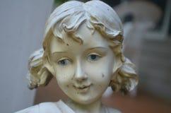 蓝眼睛的雕象 库存图片