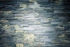 蓝绿色岩石分层堆积墙壁纹理背景 图库摄影