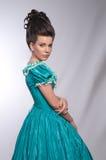 蓝绿色礼服被塑造的女孩老纵向 库存照片