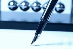 蓝绿色钢笔 免版税库存照片