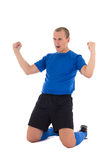 蓝色一致的庆祝的目标的足球运动员在白色backgrou 图库摄影