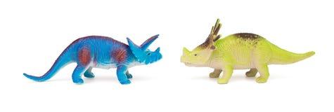 蓝色三角恐龙和绿色戟龙在白色背景戏弄 图库摄影