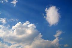 蓝色云彩光芒天空星期日 库存图片